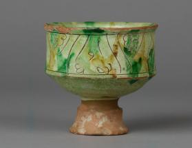Pedestal cup with decoration of leaves and wavy lines