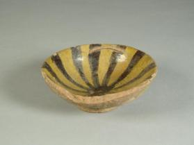 Poly-glaze ware bowl with radial desgin