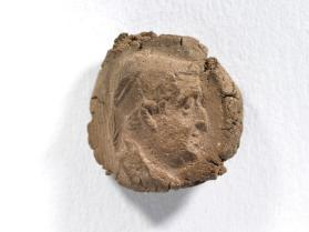 Seal impression of older male bust wearing diadem