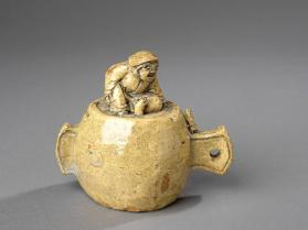 Okimono figure of daikoku seated on out-sized mallet with 2 rats