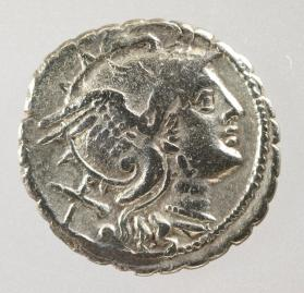 Serrate denarius with helmeted head of Roma