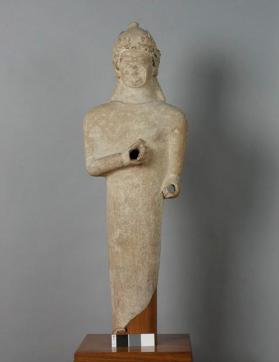 Figure of a male votary wearing a conical helmet with oak leaves and acorns