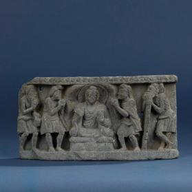 Relief with Buddha and attendants