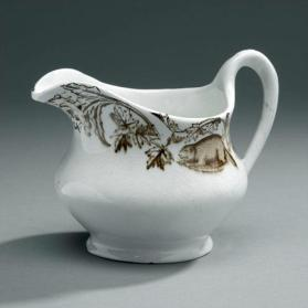 "Cream pitcher in ""Maple"" pattern"