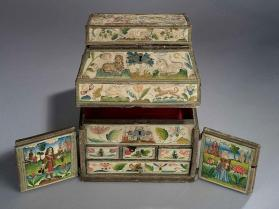 Woman's double cabinet depicting the story of Isaac and Rebekah, with travelling case