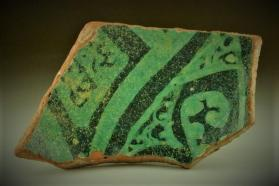 Turquoise slip-painted ware vessel fragment (body sherd)