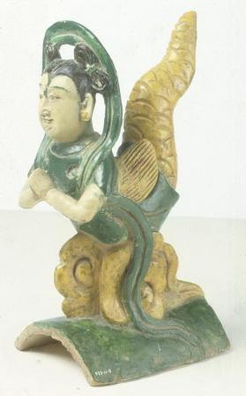Ridge tile with a tailed deity