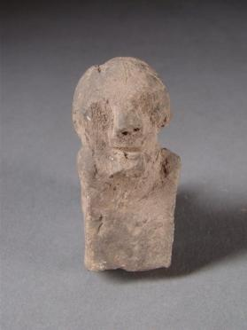 Human-headed figure with incised hair