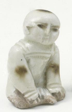 Ding ware figure of a seated child