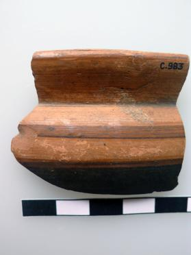 Fragment of the rim of an East Greek cup with black gloss paint decoration.