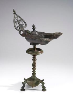 Lamp with openwork handle and twin nozzles