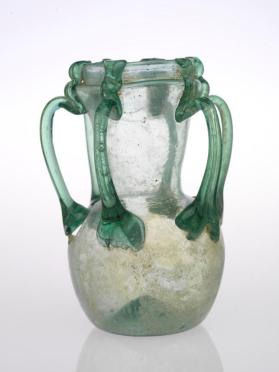 Six-handled green glass jar