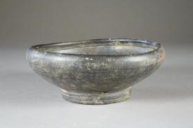 Bowl with incurving rim stamped with palm leaf motif