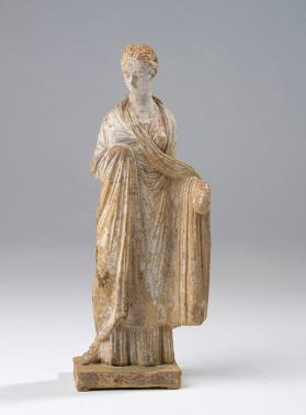 """Tanagra"" figure of a standing woman"