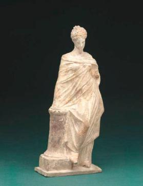"""Tanagra"" figure of young woman"