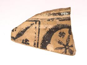 Fragment from a large krater possibly made in the Cyclades or Argos.  The geometric-style silhouette decoration shows florals, wheels and rosettes