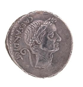 Denarius coin with wreathed head of Julius Caesar on obverse side