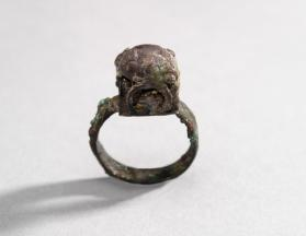 Ring with dome-shaped bezel