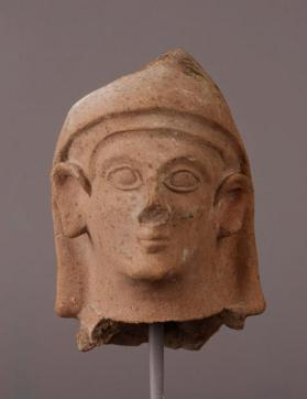 Head of male votary figure with head covering