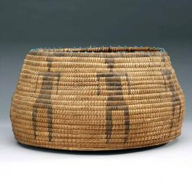 Coiled basket with 'man' design