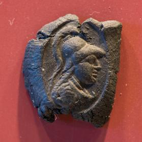 Seal impression with bust of Athena wearing a crested Corinthian helmet
