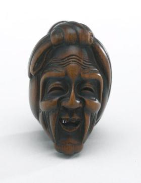Netsuke in form of Jô and Uba masks