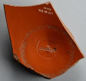 Samian ware bowl base fragment