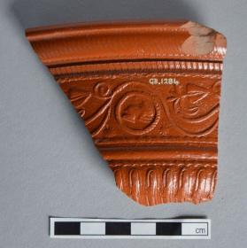Fragment of Samian ware bowl with scrolling tendril and rabbit medallion motifs
