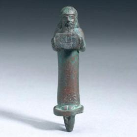 Figure of male with devotional offering