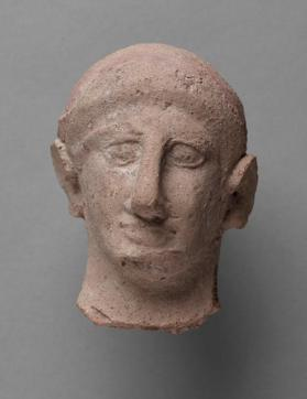 Head of male votary figure