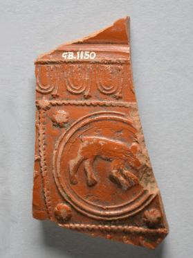 Fragment from a Samian ware bowl with animal motif in medallion