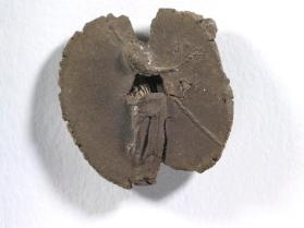 Seal impression of standing Isis-Demeter, crowned; holding sceptre, poppies, and corn