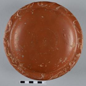 Intact Samian ware dish with moulded leaf motif