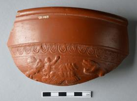 Rim fragment of a Samian ware bowl with quadriga, lion and bear
