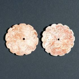 Pair of ear ornaments decorated with a profile face