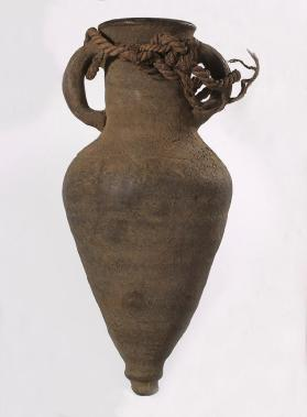 Wine amphora with a piece of rope attached through handles