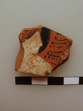 Fragment of an Attic vessel, perhaps a krater, decorated in red figure technique with a female head.