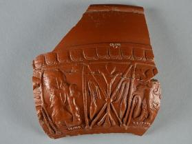 Samian ware bowl fragment with Diana holding a bow and bearing a hart