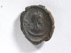 Seal impression of Isis, crowned with disk, hair in three plaits