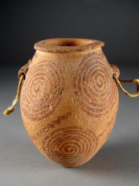 Ovoid hanging jar decorated with spirals and wavy lines