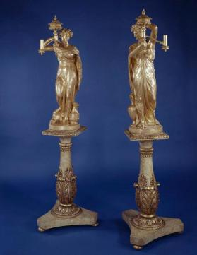 Classical figures holding argand lamps