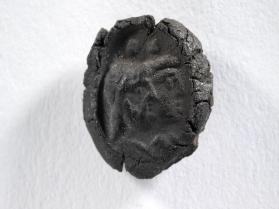 Seal impression of Sarapis and Isis, both draped and with disk