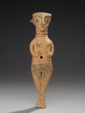 Standing female votive figure