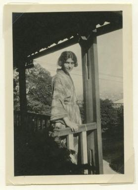 Photograph of European woman in a kimono standing in a balcony