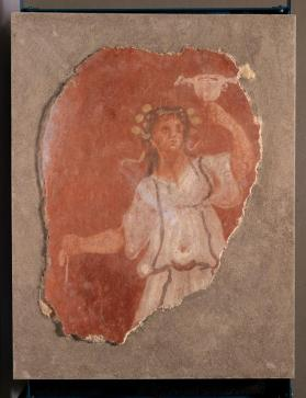 Fresco fragment of standing Maenad holding drinking cup