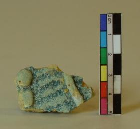 Turquoise slip-incised ware vessel fragment (body sherd)