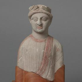 Figure of draped male votary
