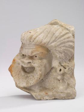 Fragment of a relief sculpture with a theatrical mask