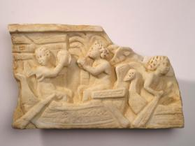 Fragment of sarcophagus relief with three putti in two boats