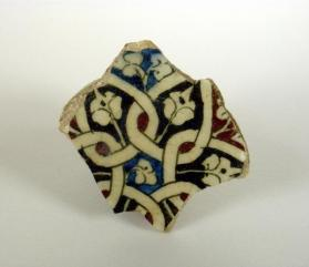 Underglaze-painted bowl fragment (base sherd)